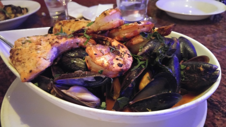 Piatto Di Pesce: A platter of seasonal fresh seafood including jumbo tiger prawns, wild caught scallops, mussels, clams & filets of fish in a light tomato broth